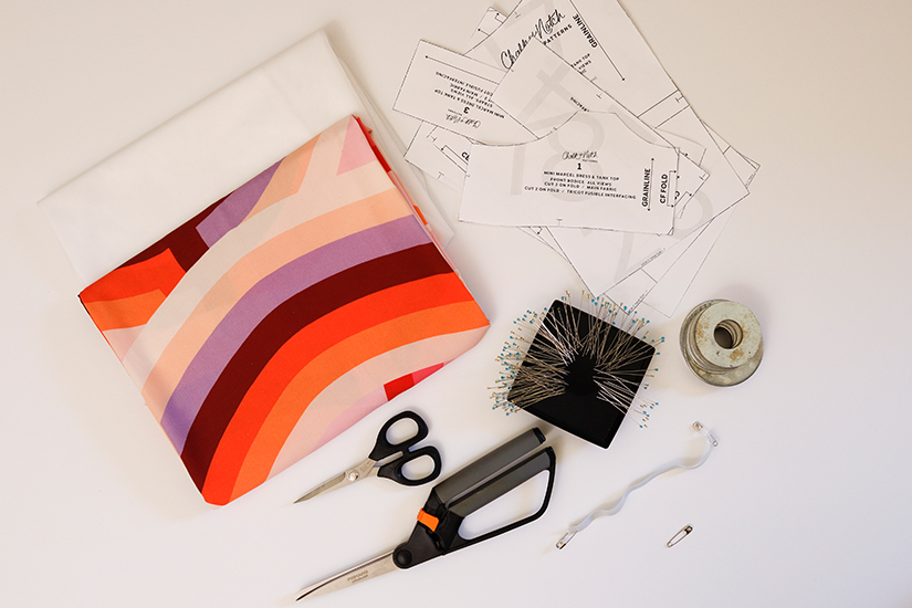 Fabric, interfacing, Marcel Pattern pieces, and various sewing notions are shown on a white background