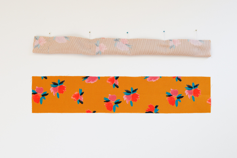 Two Marcel pattern strap pieces are shown against a white background. One is right side up while the other is folded lengthwise with pins holding it at top.