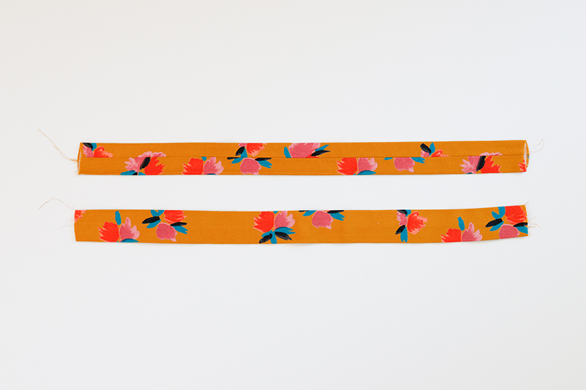 Two Marcel pattern strap pieces are shown against a white background. Both are turned right side out and pressed flat with the seam centered.
