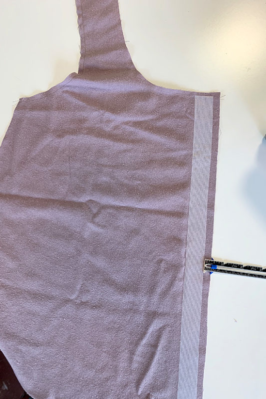 Tank top pattern piece is shown with interfacing fused to center front.