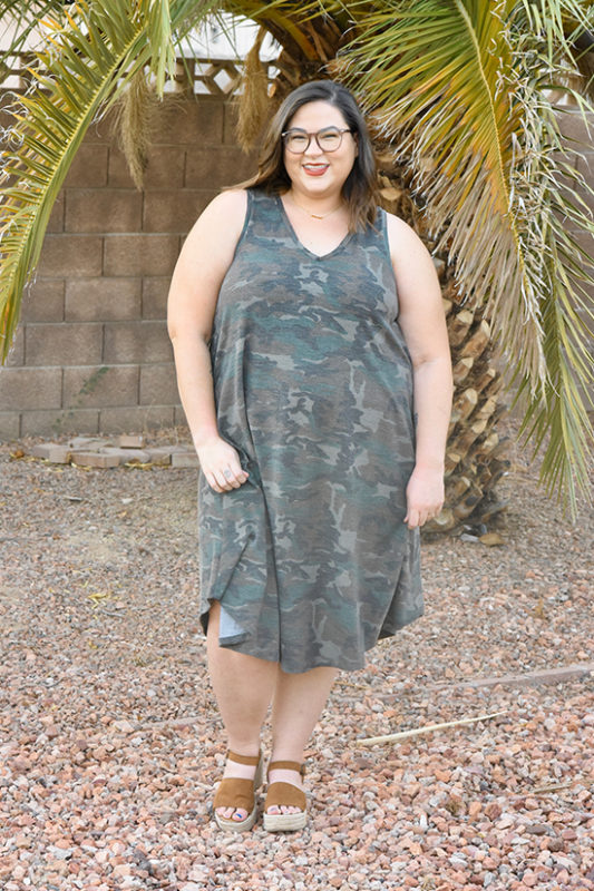 A woman wearing a Pony Tank dress in camo fabric.