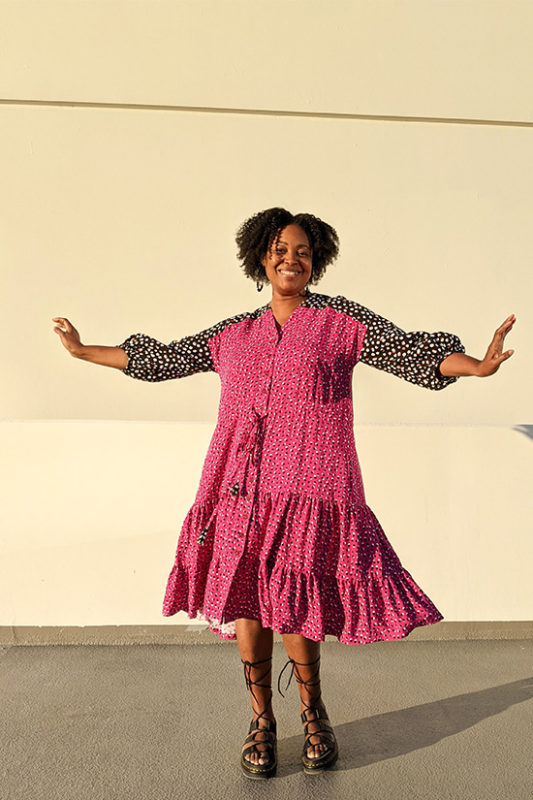 Pauline twirls in  a pink and black polka dot Fringe Dress