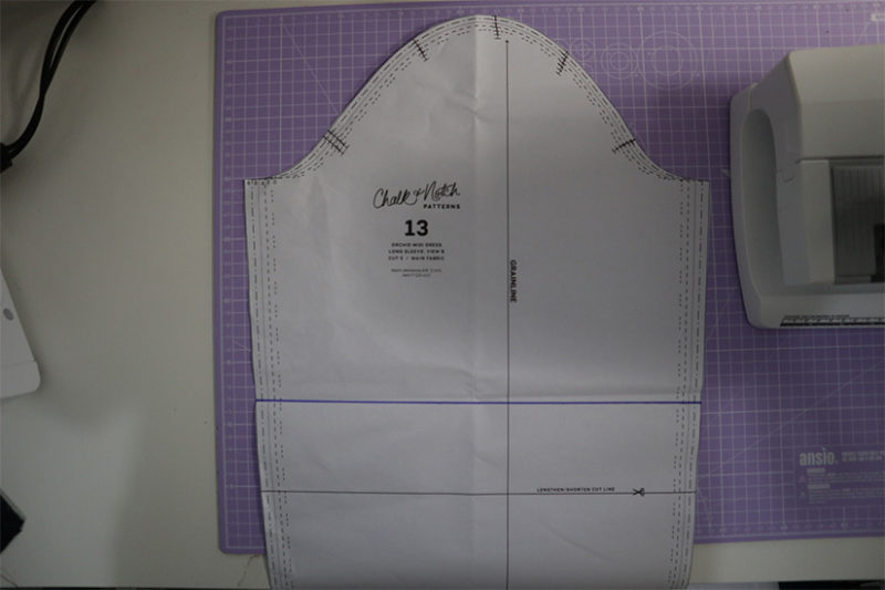 Orchid sleeve pattern piece shown on cutting mat.