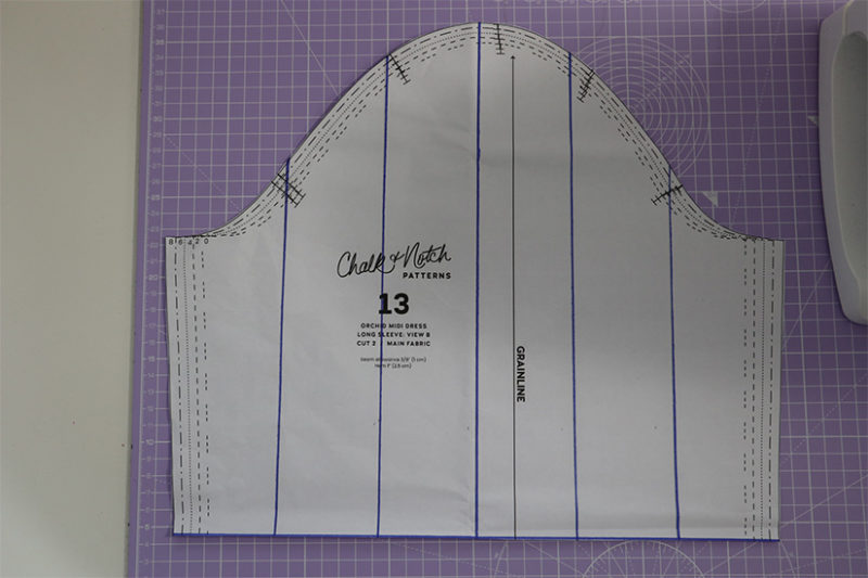 Orchid Midi sleeve pattern piece is shown with vertical lines drawn in blue.