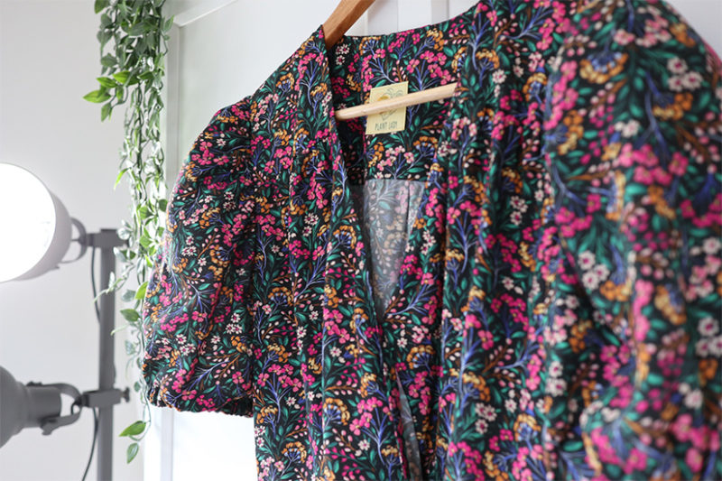Close up of floral puff sleeve Orchid Midi dress bodice