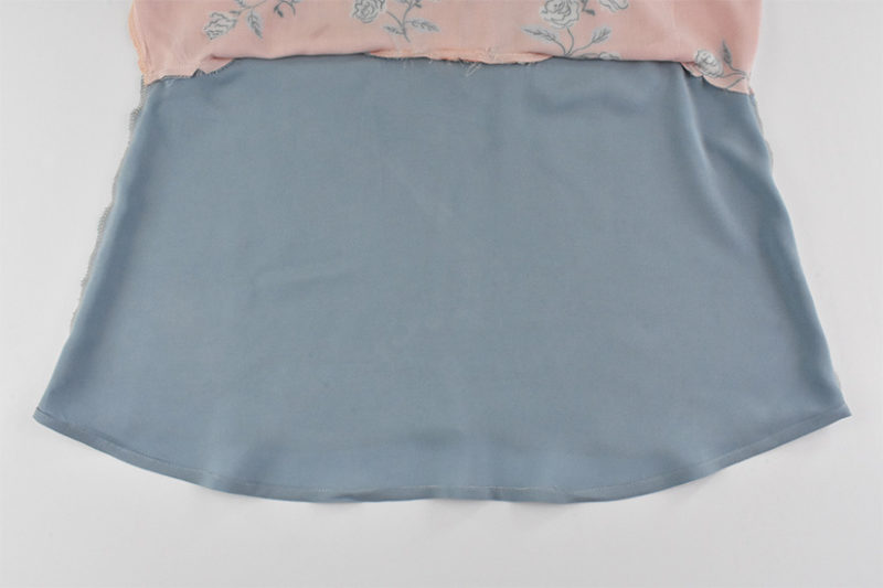 Sewn hem of lining is shown
