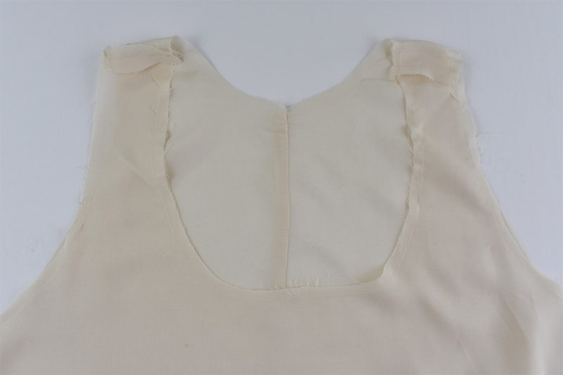 Cream lining pieces are sewn together at the shoulders