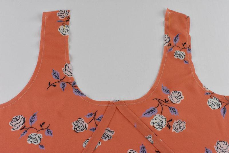Straps are sewn along the edge of the bodice neckline.