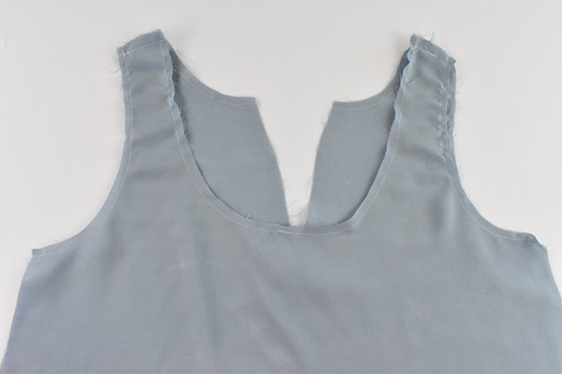 Shoulder seams of lining fabric are shown sewn.