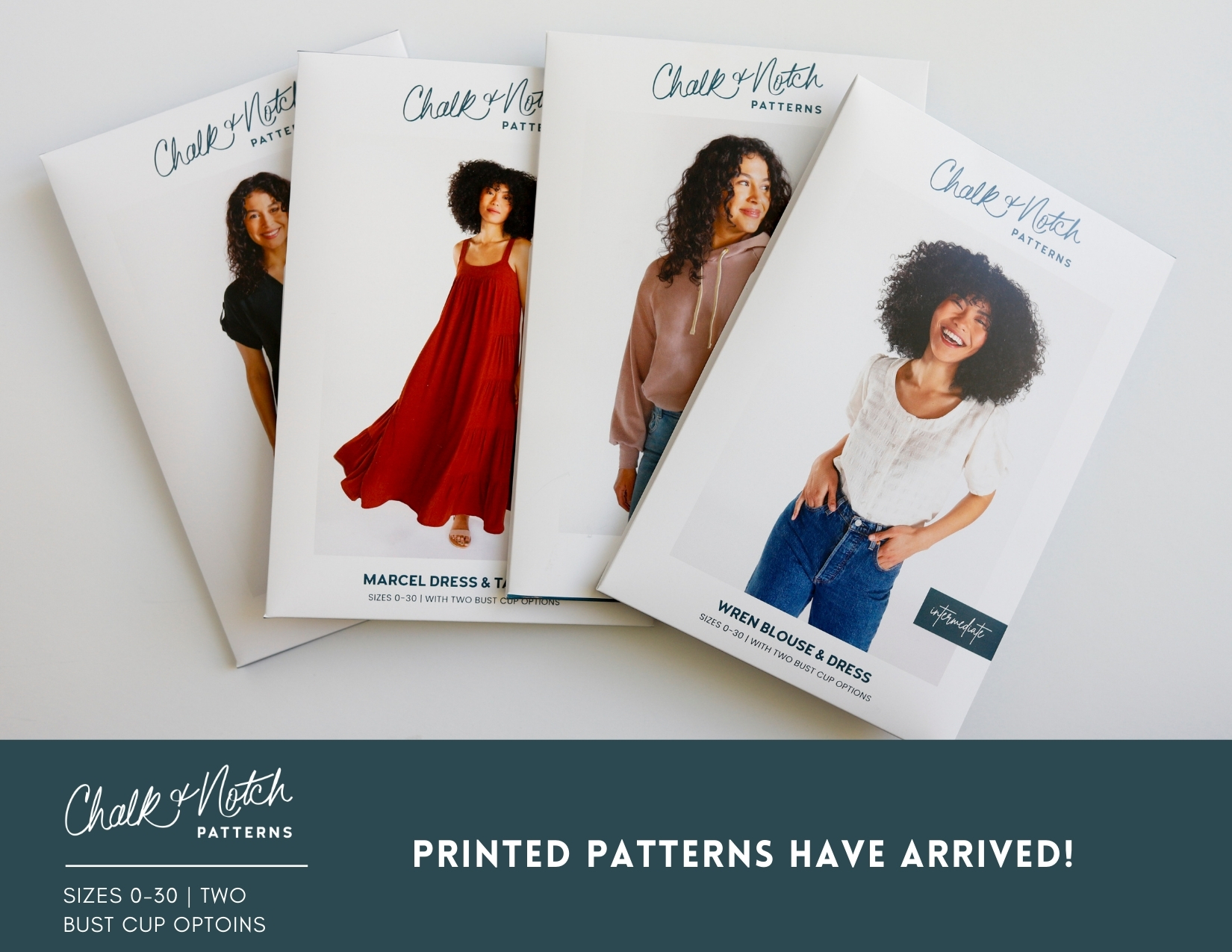 A flat lay of the envelopes of four printed sewing patterns.