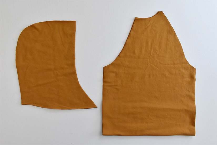 Gold colored fabric pieces cut for a Page Hoodie