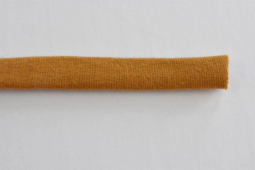 A yellow fabric tube is shown turned right side out.