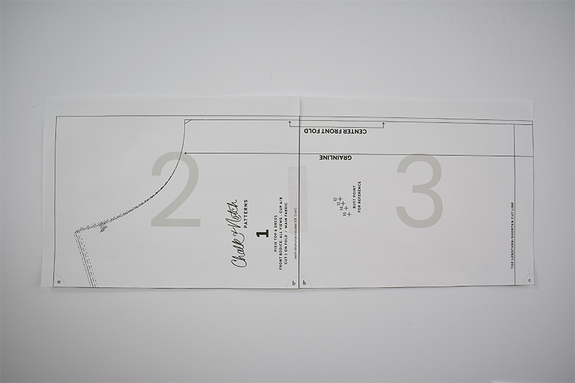 Two pages of a pdf sewing pattern are shown taped together.
