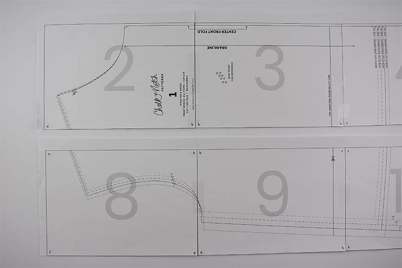 Two rows of a pdf sewing pattern are shown taped together.