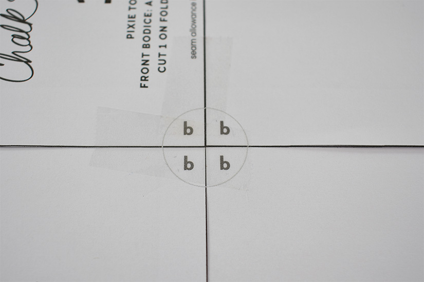 Four corners of a pdf sewing pattern create a circle with the letter b in each corner.