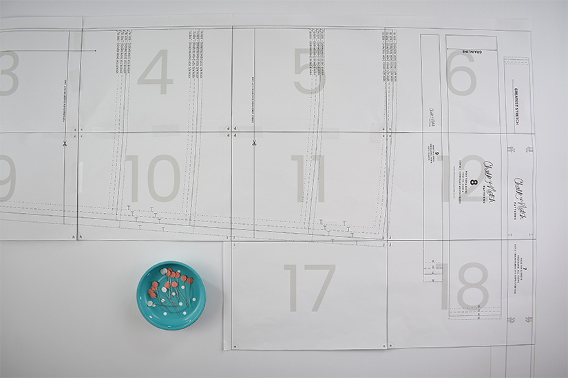 Several pages of a pdf sewing pattern are taped together.