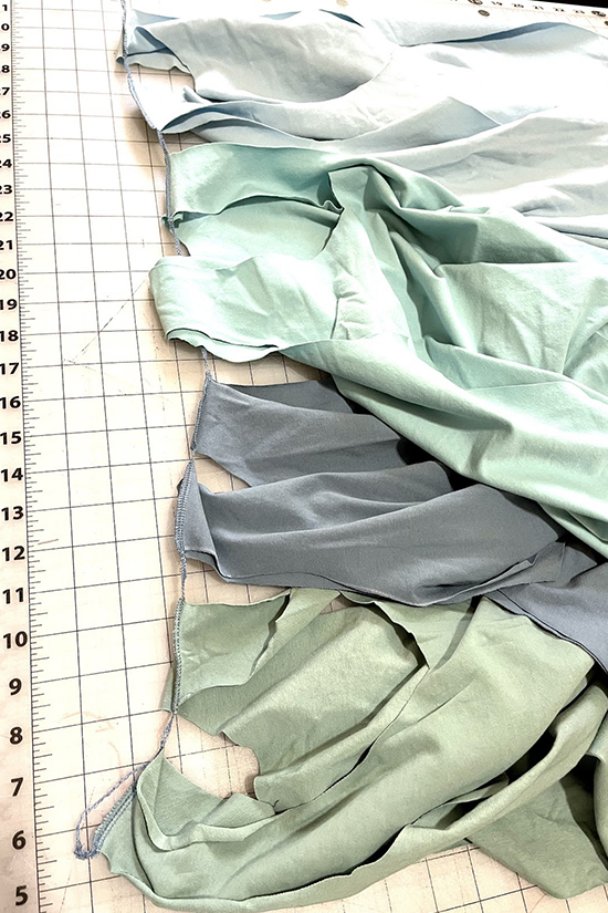 Four Pony tanks are shown sewn together at shoulder seams.