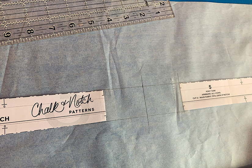 A ruler and new arm band are shown on tracing paper.