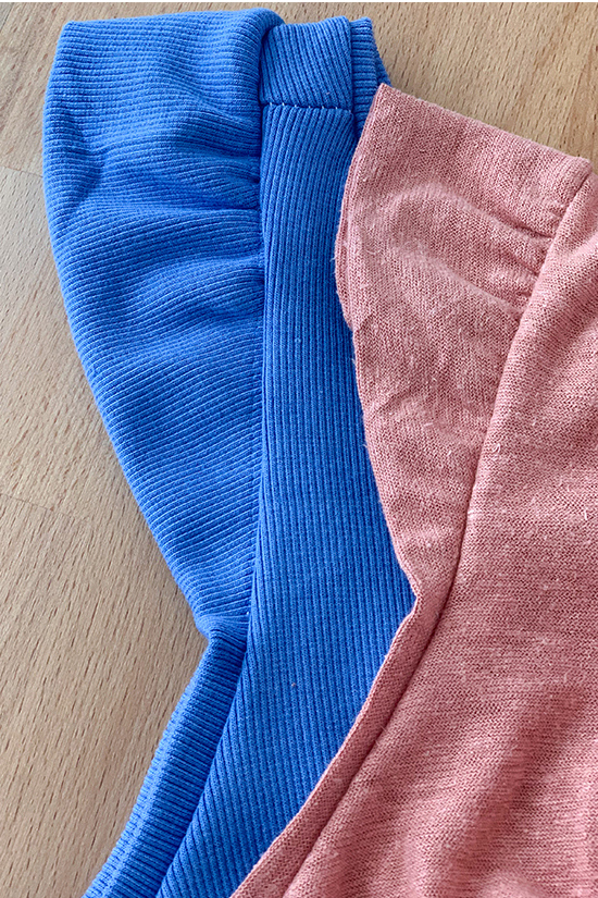 The ruffle armband is shown attached to both a blue and Pink tank top.