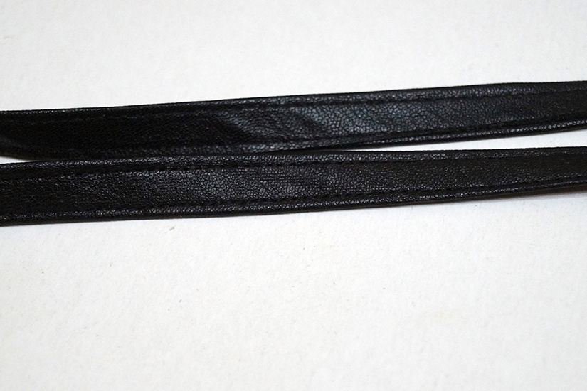 Two thin belt loops of faux leather are shown.